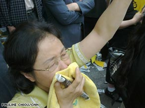 A mourner in Seoul weeps as Roh's funeral procession passes by.