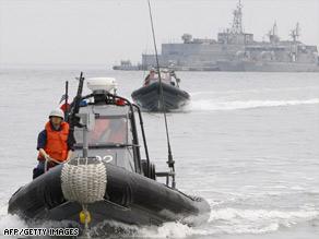 South Korean sailors take part in exercises Friday in disputed waters off the Korean Peninsula.
