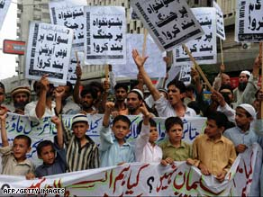 Pakistanis displaced by fighting demand government assistance during a protest Sunday in Karachi.