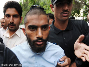 Fida Ullah, center, was arrested on Friday and publicly identified on Monday in Islamabad, Pakistan.