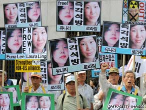 Demonstrators in South Korea vy for the journalists release