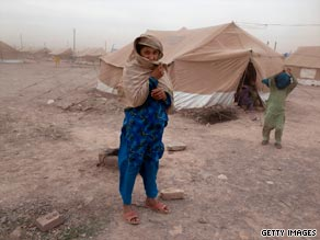 Pakistani displaced battle severe winds and dust at Jalozai refugee camp near Peshawar.