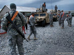 U.S. soldiers at the Bagram  base in Afghanistan prepare for a mission earlier this year.