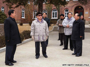 North Korean leader Kim Jong Il, center, as seen at Wonsan University of Agriculture in an undated photo