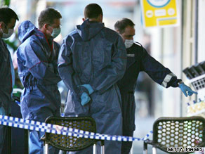 Police investigate the scene where Des Tuppence Moran was slain in Melbourne in June 2009.