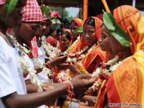 Indian brides and grooms from the Adivasi tribe take part in a mass marriage ceremony.