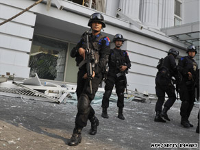 Counter-terrorist police commandos secure the damaged Ritz-Carlton hotel in Jakarta on Friday after the blasts.