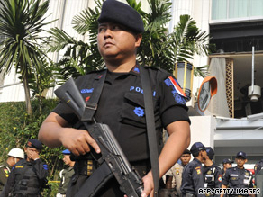 Indonesian counter-terrorist police commandos secure the damaged Ritz-Carlton hotel in Jakarta.