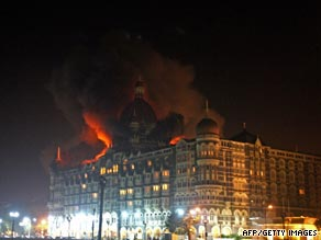 Mumbai's Tai Mahal hotel burns during last November's attack by gunmen.