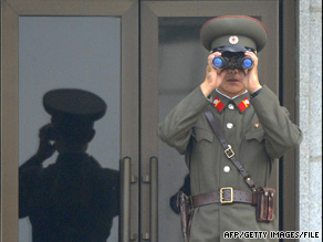 A North Korean soldier looks at the South Korean side of the demilitarized zone earlier this month.