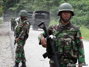 Indonesian soldiers provide security near a PT Freeport-owned gold mine in Timika, Papua province, on July 18.