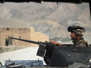 A French soldier mans a gun Sunday during maneuvers in Afghanistan's Kapisa province.