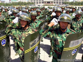 Chinese paramilitary militia chant patriotic slogans during a troop review in Urumqi, China, on July 28.