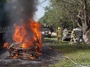 A car burns after the suicide blast outside NATO's Afghanistan headquarters last month.