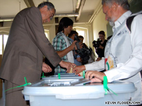 A voter dips his finger into ink after voting at a polling station in Kabul, Afghanistan.