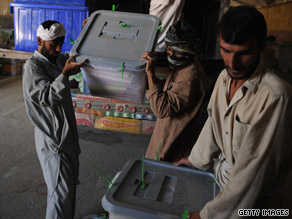 Election workers unload ballot boxes Sunday at the Independent Election Commission headquarters in Kabul.