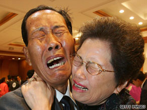 North Korean Yun Young-Seob hugs his South Korean sister Yun Bok-Seob at a 2007 reunion in North Korea.