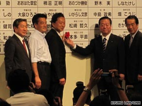 Yukio Hatoyama, third left, leader of the Democratic Party of Japan, celebrates the election results Sunday in Tokyo.