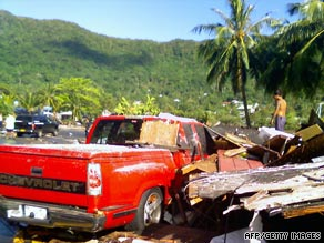 Debris clutters a road in Pago Pago, American Samoa, after a devastating earthquake and tsunami last month.