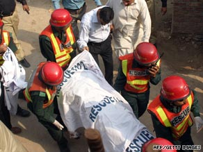 Pakistani authorities remove bodies from the scene of Thursday's deadly attacks in Lahore.