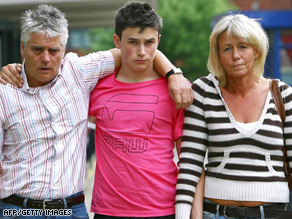 The father, brother and mother of Rob Knox pose together after the death of the young actor.