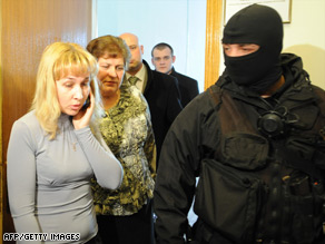 Ukrainian security service agents let employees leave a room at Naftogaz's headquarters.