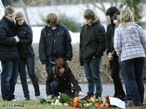Teenagers lay flowers at the school where Tim Kretschmer began his rampage.
