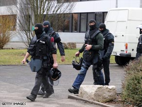 Police launched a manhunt for the 17-year-old gunman who was said to be heavily armed.