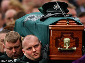 Stephen Carroll's coffin is carried from St Therese's chapel in Banbridge, Northern Ireland, on March 13.