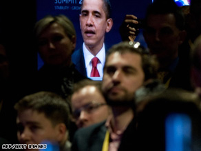 People in London watch U.S. President Barack Obama speak late Thursday following the G-20 summit.
