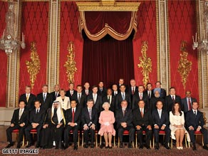Just after this photo was taken, the Queen, center, appears to get annoyed with Silvio Berlusconi.