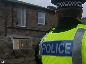 A house in Manchester, England, is searched Wednesday as part of the counterterrorism operation.