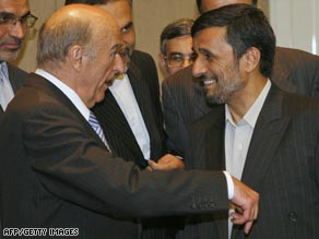 Swiss President Hans-Rudolf Merz, left, greets Iranian President Mahmoud Ahmadinejad following his arrival in Switzerland.