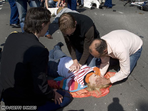 A victim is helped after the car crashed into the crowd in the Dutch town of Apeldoorn.