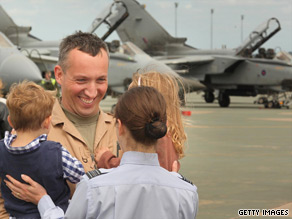 An RAF pilot greets his family earlier this month in England on his return from Iraq.