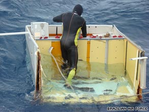 A Brazilian diver floats on wreckage of Flight 447 spotted last week.