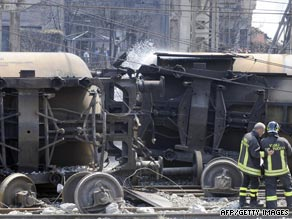 Firemen check a wrecked freight train in Italy after gas tankers exploded.