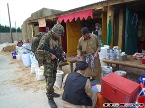 A British soldier on patrol in the mock Afghan village of Sindh Kalay.