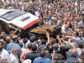 Egyptians take part in the funeral of Marwa Sherbini, who was murdered in Germany last week.