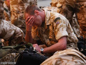 A British Marine is shown in Arbroath, Scotland, last year on the eve of a six-month tour of duty in Afghanistan.