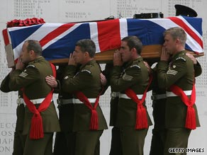 Soldiers from the Welsh Guards carry the coffin of Maj Sean Birchall, killed on patrol in Afghanistan in June.