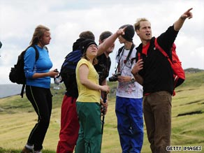 Prince William, right, joined a group of homeless teams on a mountain climb in the UK.