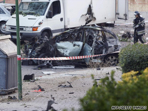 The wreck of a car outside a civil guards barracks in the city of Burgos on July 29.