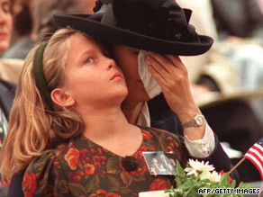 Victoria Cummock holds daughter Ashley during a 1995 memorial service. John Cummock died in the bombing.