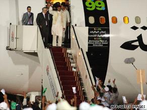 Abdelbaset Ali Mohmed al Megrahi (second from left) arrives in Tripoli, Libya.