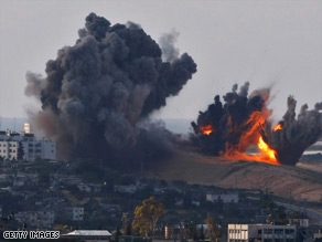 Israeli air force bombs explode Thursday in Gaza, where more than 400 Palestinians have been killed.