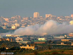Smoke rises after an Israeli air strike on the Gaza Strip early Monday.