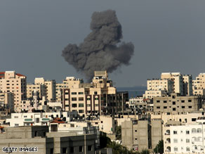 Smoke from shells fired by the Israeli military rises in Gaza City on Sunday.