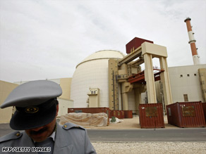 An Iranian guard stands in front of the building housing the Bushehr nuclear power plant's reactor Wednesday.