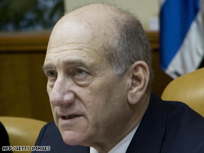 Iran has called for the arrest of Prime Minister Ehud Olmert on war crimes charges for Israel's Gaza offensive.